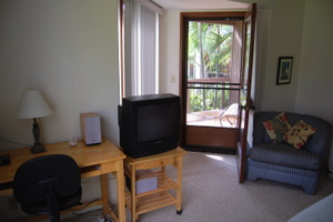 Master bedroom w/ tv and stereo, second lanai